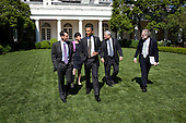 President Barack Obama walks through the Rose Garden of the White House for an outdoor meeting with senior staff, May 9, 2011. Walking with the President, from left, are: Senior Advisor David Plouffe, Senior Advisor Valerie Jarrett, Counselor to the President Pete Rouse, and Counsel to the President Bob Bauer..Mandatory Credit: Pete Souza - White House via CNP