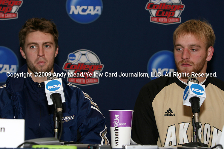 11 December 2009: Akron's Blair Gavin (left) and David Meves (right) during the postgame press conference. The University of Akron Zips defeated the University of North Carolina Tar Heels 5-4 on penalty kicks after the game ended in a 0-0 overtime tie at WakeMed Soccer Stadium in Cary, North Carolina in an NCAA Division I Men's College Cup Semifinal game.