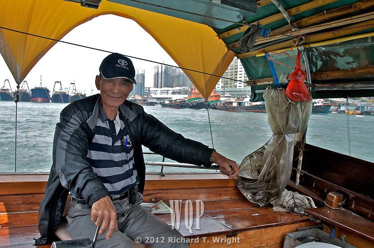 Aberdeen harbour, Hong Kong Island  A captain plys his sampan ferry through the harbor of Aberdeen on the south shore of Hong Kong Island.