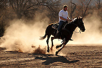From sunrise to sundown a wranglers day is spent breaking horses, herding cattle, planting fields, and mending fences.
