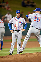 Round Rock Express manager Jason Wood (40) looks on as relief pitcher Tyler Wagner (35) warms up during a game against the Memphis Redbirds on April 28, 2017 at AutoZone Park in Memphis, Tennessee.  Memphis defeated Round Rock 9-1.  (Mike Janes/Four Seam Images)