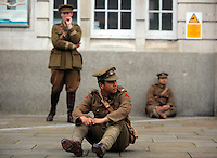 Men in World War I gear outside Swansea Railway Station, south Wales UK. Friday 01 July 2016