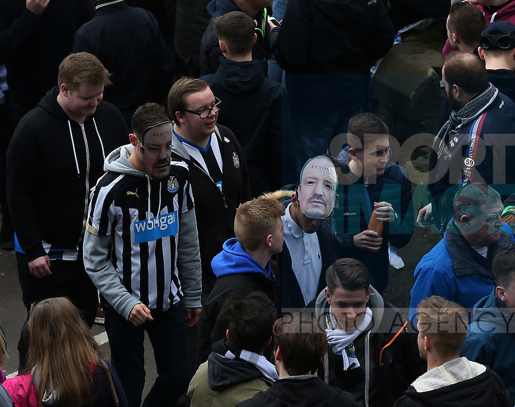 Newcastle United supporters are seen wearing Rafael Benitez facemasks ahead of the Barclays Premier League match at St James' Park Stadium. Photo credit should read: Scott Heppell/Sportimage