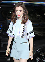 Lily Collins Seen In NYC