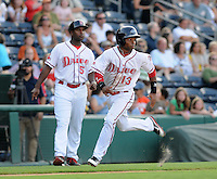 Outfielder Matty Johnson (13) of the Greenville Drive, Class A affiliate of the Boston Red Sox, in the second game of a doubleheader against the Rome Braves on August 15, 2011, at Fluor Field at the West End in Greenville, South Carolina. (Tom Priddy/Four Seam Images)