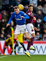 26th January 2020, Tynecastle Park, Edinburgh, Scotland; Scottish Premier League football, Hearts of Midlothian versus Rangers; Sean Clare of Hearts and Borna Barisic of Rangers compete for possession of the ball