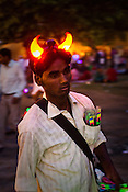 A vendor is seen sporting the devil horns near India Gate in New Delhi, India  Photograph: Sanjit Das/Panos