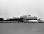 Pittsburgh PA 1955: View of the parking lot at the Greater Pittsburgh Airport in 1953. In 1944, Allegheny County officials proposed to expand the military airport with the addition of a commercial passenger terminal in order to relieve the Allegheny County Airport, which was built in 1926 and whose capacity was quickly becoming insufficient to support the growing demand for air travel.  The new airport, christened as Greater Pittsburgh Airport opened on May 31, 1952. The first flight occurred on June 3, 1952.
