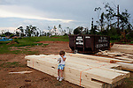 Krista Holbrooks, 5, sits on her grandfather's property near where her house is being rebuilt after an April tornado tore apart the Vaughn community and destroyed both homes on the property.