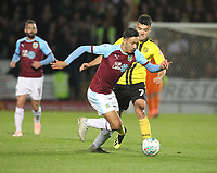 Burnley's Dwight McNeil battles with  Burton Albion's Scott Fraser<br />