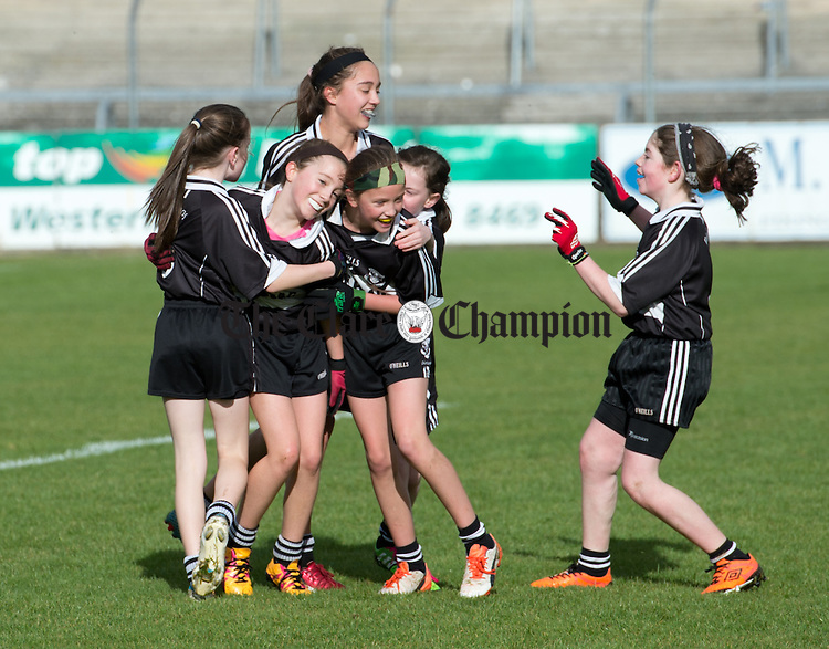 Bansha/Clohanes players celebrate their win over Stonehall NS in Division 3 at the Cumann na mBunscoil Finals in Cusack Park. Photograph by John Kelly.