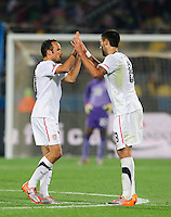 Landon Donovan of USA celebrates his penalty goal with Clint Dempsey. Ghana defeated the USA 2-1 in overtime in the 2010 FIFA World Cup at Royal Bafokeng Stadium in Rustenburg, South Africa on June 26, 2010.