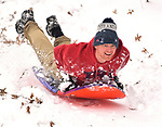 Sean Hall of Belleville zooms down a steep slope at East End Park in Belleville on Saturday morning January 12, 2019. People were busy digging out -- and some were having fun -- after a major snowstorm hit the St. Louis metropolitan region. <br /> Photo by Tim Vizer
