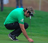 Victor Dubuisson (FRA) on the 1st green during Thursday's Round 1 of the 2014 BMW Masters held at Lake Malaren, Shanghai, China 30th October 2014.<br /> Picture: Eoin Clarke www.golffile.ie