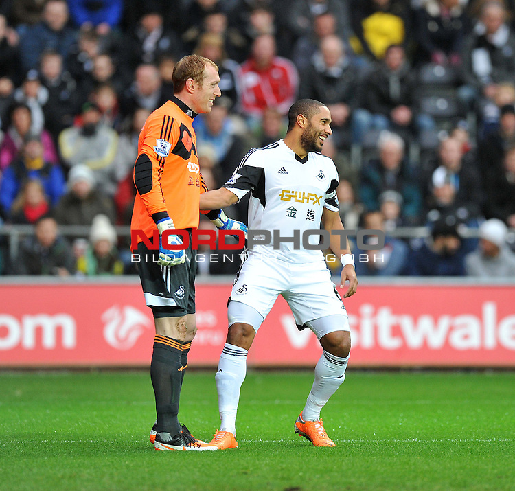 Swansea City's Ashley Williams shares a joke with Swansea City's Gerhard Tremmel after having to change his shirt due to clashing with Manchester City's away kit. -  01/01/2014 - SPORT - FOOTBALL - Liberty Stadium - Swansea - Swansea City v Manchester City - Barclays Premier League<br /> Foto nph / Meredith<br /> <br /> ***** OUT OF UK *****