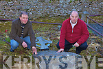 ABBEY: Locals Oliver Savage and Dan Cronin with one of the headstones in Killaha Abbey in Milltown which were knocked by vandals.