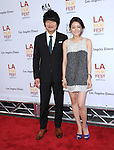 Song Kang Ho and Ko Asung attends The LOS ANGELES FILM FESTIVAL Opening Night Gala: SNOWPIERCER held at Regal Cinemas  in Los Angeles, California on June 11,2014                                                                               © 2014 Hollywood Press Agency
