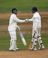 India's Zaheer Khan (right) congratulates his captain MS Dhoni on reaching his half century during day four of the 3rd test between the New Zealand Black Caps and India at Allied Prime Basin Reserve, Wellington, New Zealand on Monday, 6 April 2009. Photo: Dave Lintott / lintottphoto.co.nz.