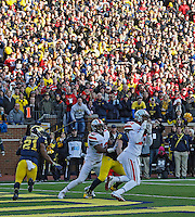 Ohio State Buckeyes defensive back Tyvis Powell (23) makes an interception during a two-point conversion against Michigan Wolverines in the 4th quarter during their college football game at Michigan Stadium in Ann Arbor, Michigan on November 30, 2013.  (Dispatch photo by Kyle Robertson)