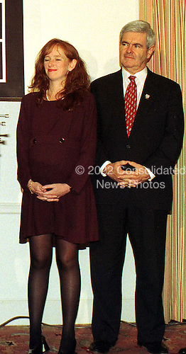 Washington, DC - November 5, 1997 -- House Speaker Newt Gingrich stands next to Mary Pat Fossella, wife of newly sworn-in United States Representative Vito J. Fosella (Republican of the 13th District of New York)  during a press confrence celebrating  Fossella's election victory the previous day..Credit: Ron Sachs / CNP.(Restriction: No New York Metro or other Newspapers within a 75 mile radius of New York City)