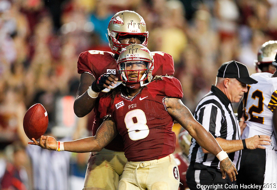 TALLAHASSEE, FLA 9/21/13-FSU-BCC092113CH-Florida State's Devonta Freeman, center,celebrates his touchdown against Bethune-Cookman with Cameron Erving during first half action Saturday at Doak Campbell Stadium in Tallahassee. <br /> COLIN HACKLEY PHOTO