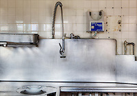 Dishwashing Station in Large Commercial Kitchen. Dating to 1927, the Masonic Retirement Center, locally known as the Masonic Home, in Des Moines, Washington is now an elegant event center available for rental.  In the historic Zenith neighborhood of the city of Des Moines. Please conact douglasorton@comcast.net regarding licensing of this image.
