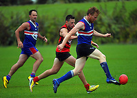 Action from the Wellington Australian Rules Football club final match between the Bulldogs (blue)  and North City Demons at Hutt Park, Wellington, New Zealand on Saturday, 22 November 2014. Photo: Dave Lintott / lintottphoto.co.nz