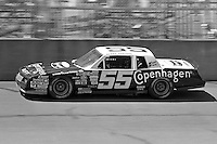 BROOKLYN, MI - AUGUST 11: Benny Parsons drives his Chevrolet during the Champion Spark Plug 400 NASCAR Winston Cup race at the Michigan International Speedway near Brooklyn, Michigan, on August 11, 1985.