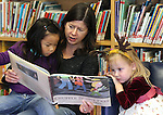 Lisa Keating reads to her daughter Dahlia, 4, left, and Kylie Lazzrino, 3-1/2, after Story Time at the Carson City Library on Thursday, Dec. 1, 2011..Photo by Cathleen Allison/Nevada Photo Source