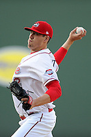 Starting pitcher Pat Light (32) of the Greenville Drive works in the first inning a game against the Kannapolis Intimidators on Friday, April 11, 2014, at Fluor Field at the West End in Greenville, South Carolina. Light was a supplemental pick (37th overall) by the Boston Red Sox in the 2013 First-Year Player Draft. (Tom Priddy/Four Seam Images)