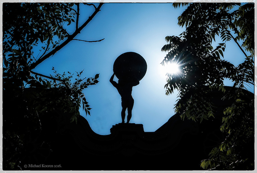 01-06-2016, Utrecht, Netherlands, A statue of Atlas is seen on the roof of a building in the city of Utrecht<br /> &copy; photo : Michael Kooren.