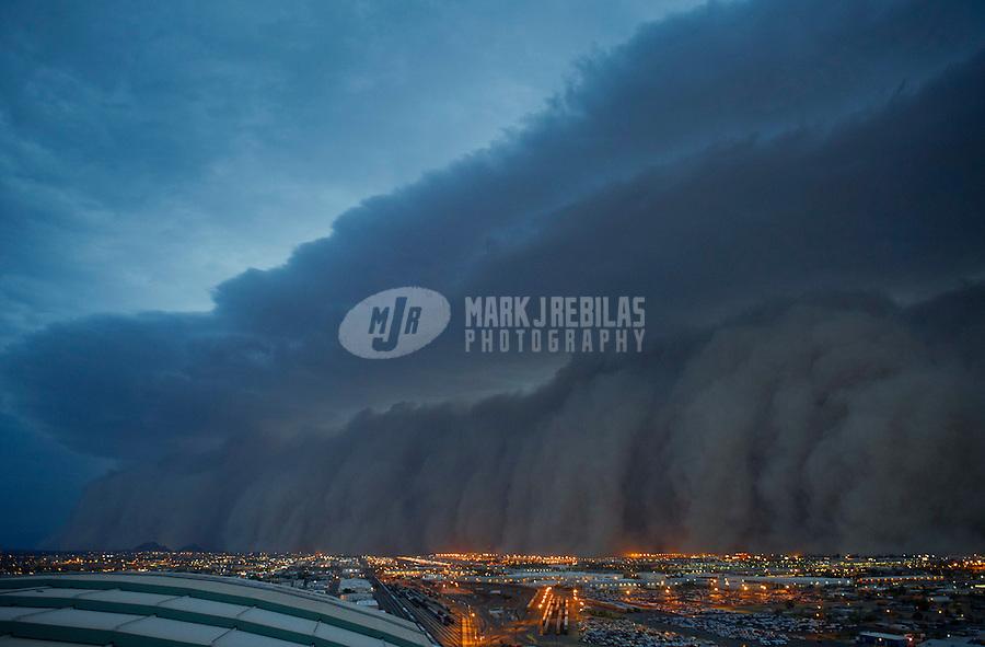 Apr. 26, 2011; Phoenix, AZ, USA; A dust storm converges on downtown Phoenix  haboob sandstorm dust monsoon storm chaser chasing city dusk Arizona