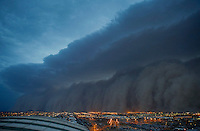 Apr. 26, 2011; Phoenix, AZ, USA; A dust storm converges on downtown Phoenix  haboob sandstorm dust monsoon storm chaser chasing city dusk Arizona