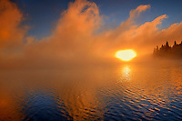 Fog at sunrise on Caddy Lake<br /> Whiteshell Provincial Park<br /> Manitoba<br /> Canada