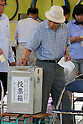 July 10, 2016, Tokyo, Japan - A voter casts a vote in Japan's Upper House election at a polling station in Tokyo on Sunday, July 10, 2016. Polling stations opened early across the nation in a Upper House election with 389 candidates vying for 121 seats.    (Photo by Yoshio Tsunoda/AFLO) LWX -ytd-
