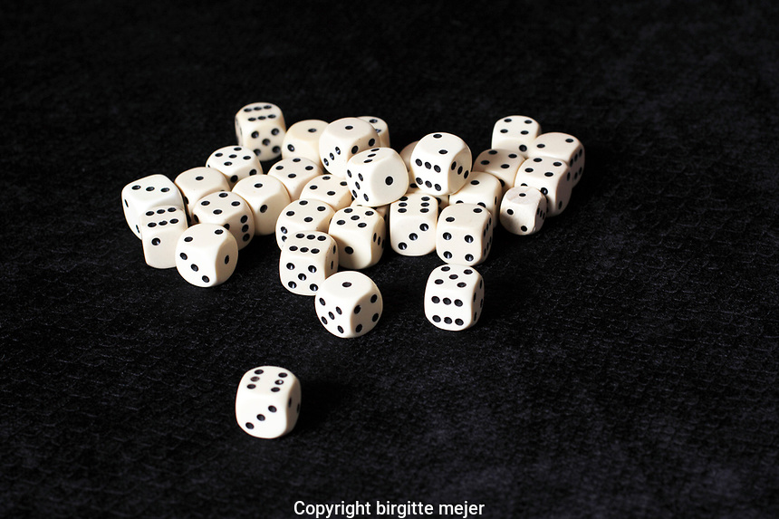 white dice's on a black cloth. Studio photography