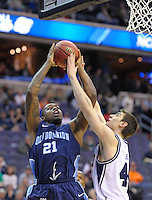 Frank Hassell of the Monarchs shoots over Andrew Smith of the Bulldogs. Butler defeated Old Dominion 60-58 during the NCAA tournament at the Verizon Center in Washington, D.C. on Thursday, March 17, 2011. Alan P. Santos/DC Sports Box