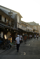 Street at dusk, Kurashiki, Okayama Prefecture, Japan, July 11, 2013. The historic city of Kurashiki is popular with tourists for its fine Edo Period(1603-1868) and Meiji Period (1868-1912) architecture.