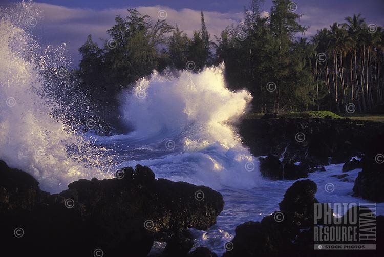 Waves crash against lava rocks in Keanae, Maui.