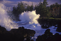 Waves crash against lava rocks in Keanae, Maui.