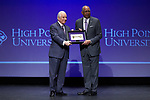 High Point University President Dr. Nido Qubein (left) presents the key to High Point University to the new men's basketball head coach Tubby Smith (right) during an event at the Hayworth Fine Arts Center on the campus of High Point University on March 27, 2018 in High Point, North Carolina.  (Brian Westerholt/Sports On Film)