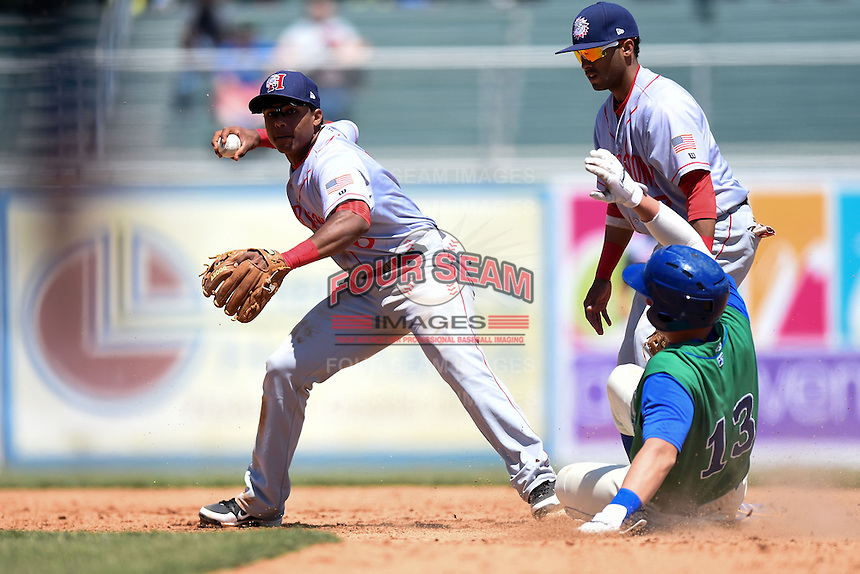 Hagerstown Suns shortstop Wilmer Difo (6) attempts to turn a double play as Frank Schwindel (13) slides in and Willie Medina (17) backs up the play during a game against the Lexington Legends on May 19, 2014 at Whitaker Bank Ballpark in Lexington, Kentucky.  Lexington defeated Hagerstown 10-8.  (Mike Janes/Four Seam Images)