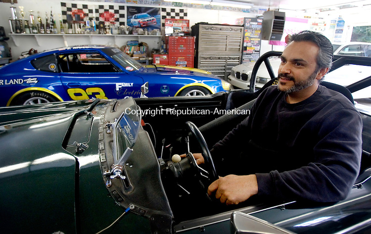 WOODBURY, CT. 01 March 2013-030113SV01-Joe Riolo, of Woodbury sitting on one of his vintage cars at his home in Woodbury Friday. Riolo is planning to open a garage repair shop in town. Woodbury introduced a volunteer business ambassador program to walk people looking to start or expand a business through the land use process. Steven Valenti Republican-American