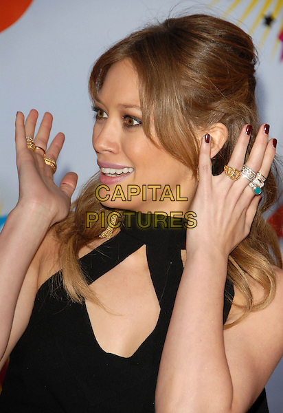 HILARY DUFF.Arrivals at The Nickelodeon's 19th Annual Kids' Choice Awards held at UCLA's Pauley Pavilion in Westwood, California, USA, April 1st 2006..half length funny hands rings black top cut out .Ref: DVS.www.capitalpictures.com.sales@capitalpictures.com.©Debbie VanStory/Capital Pictures