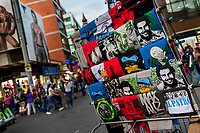 "T-shirts for sale, depicting the drug lord Pablo Escobar, are seen arranged at the market stand on the street in Medellín, Colombia, 29 November 2017. Twenty five years after Pablo Escobar's death, the legacy of the Medellín Cartel leader is alive and flourishing. Although many Colombians who lived through the decades of drug wars, assassinations, kidnappings, reject Pablo Escobar's cult and his celebrity status, there is a significant number of Colombians who admire him, worshipping the questionable ""Robin Hood"" image he had. Moreover, in the recent years, the popular ""Narcos"" TV series has inspired thousands of tourists to visit Medellín, creating a booming business for many but causing a controversial rise of narco-tourism."