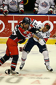 January 9th, 2009:  Kevin Harvey (27) of the Syracuse Crunch fights Kenndal McArdle (22) during the third period vs. the Rochester Amerks at Blue Cross Arena in Rochester, NY.  Rochester defeated Syracuse 3-1 for their third straight win.  Photo Copyright Mike Janes Photography 2009