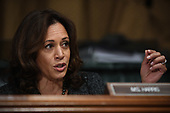 US Senator Kamala Harris, D-CA, talks to Christine Blasey Ford, the woman accusing Supreme Court nominee Brett Kavanaugh of sexually assaulting her at a party 36 years ago, during her hearing before the US Senate Judiciary Committee on Capitol Hill in Washington, DC, September 27, 2018.  / POOL / SAUL LOEB