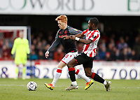 4th January 2020; Griffin Park, London, England; English FA Cup Football, Brentford FC versus Stoke City; Dru Yearwood of Brentford challenges Ryan Woods of Stoke City<br />
