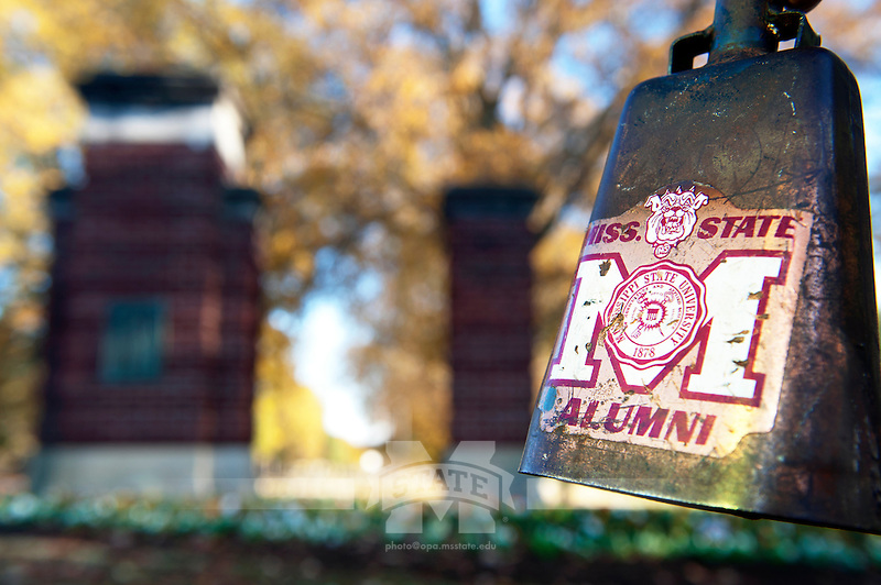 Vintage cowbell near 1922 entrance gate. (photo by Beth Newman / © Mississippi State University)