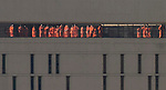 Prisoners exercise in the morning sun on the roof of the Metropolitan Correctional Center, Monday, Feb. 26, 2018, in downtown Chicago. (DePaul University / Jamie Moncrief)